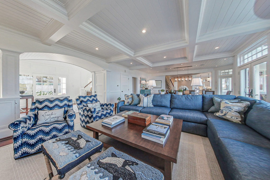 Image of the living room in a 2-story colonial style home in North Chatham, MA.